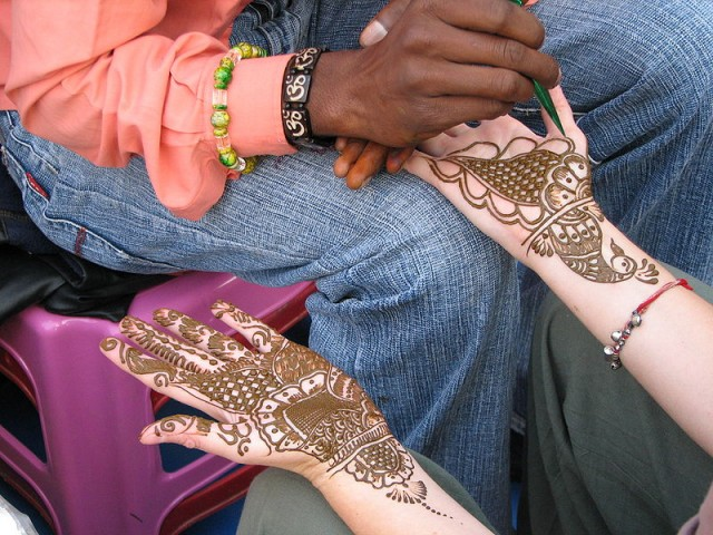 Mehndi [sited from : http://en.wikipedia.org/wiki/Mehndi#mediaviewer/File:A_Henna_or_Mehndi_applier,_Rishikesh.jpg]
